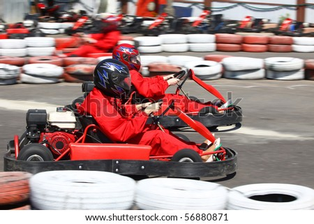 Go cart racers struggling on circuit - stock photo