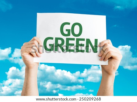 Go Green card with sky background - stock photo