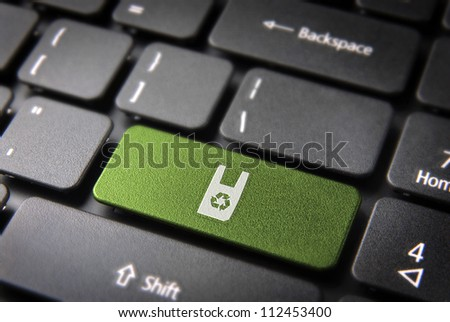 Go green key with recycle plastic bag icon on laptop keyboard. Included clipping path, so you can easily edit it. - stock photo