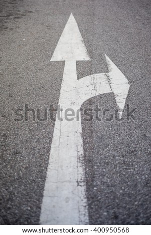 Go straight and turn right sign on street