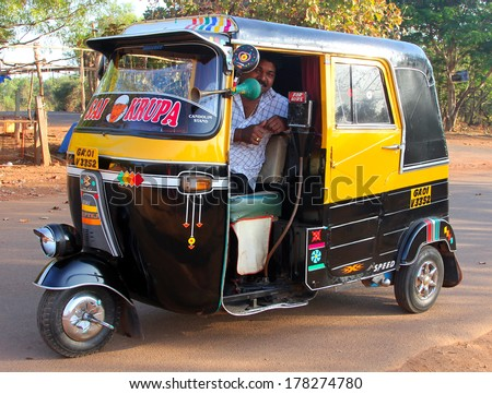 GOA, INDIA - FEB 11, 2014: Indian auto rickshaw. Auto rickshaws (mototaxi or tuk-tuk) are a common means of public transportation in many countries in the world