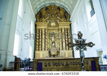 GOA, INDIA 24 MARCH 2015 : Unidentified tourist visit to ancient Basilica of Bom Jesus church, The basilica church holds the mortal remains of St. Francis Xavier.