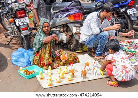 GOA,INDIA -OCTOBER 31,2011:souvenir Sellers at the market in Mapusa