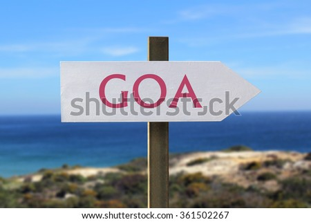 Goa sign with seashore in the background