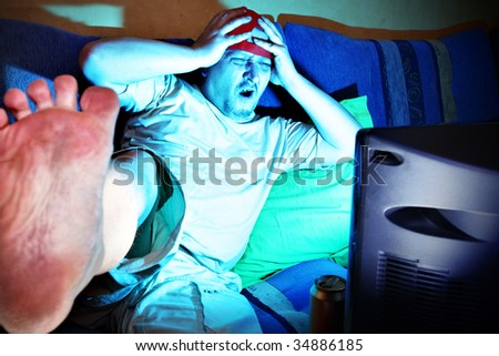 Goal - Crazy fun watching sports match by TV - stock photo