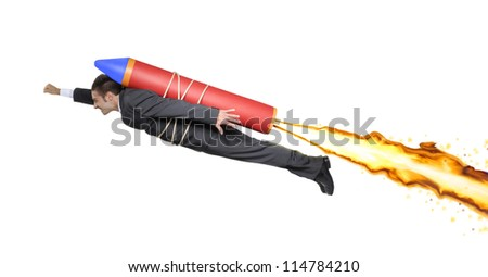 Goal leadership and focused management business concept as a businessman on a flying rocket  towards a planned target career and company success.Businessman flying on a rocket. - stock photo