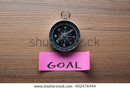 Goal : Motivation advice handwriting on label with compass - stock photo