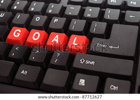goal red button word on black keyboard