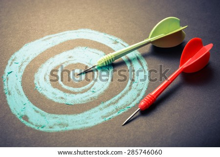 Goal setting, drawing target with darts - stock photo