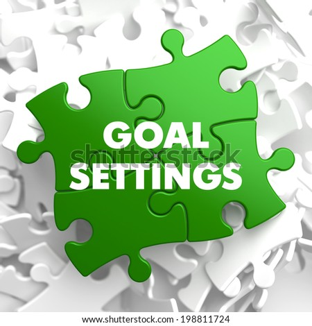 Goal Settings on Green Puzzle on White Background. - stock photo