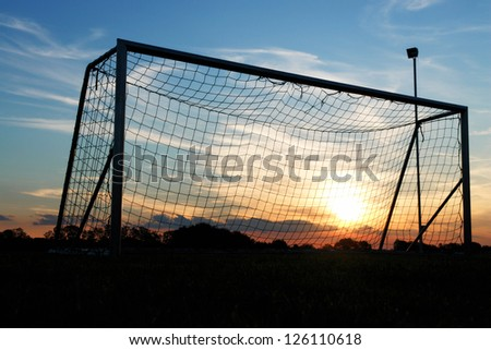 Goal shot from the corner in the front with the sunset - stock photo
