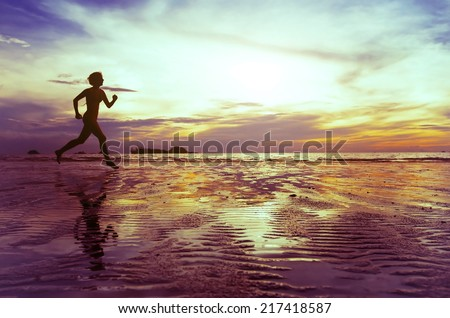 goal, silhouette of barefoot woman running on the beach