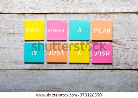 Goal without a plan is just a wish - motivational handwriting on colorful sticky notes - stock photo