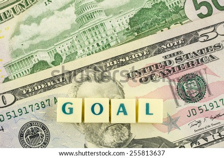 Goal word on dollar background. Finance concept