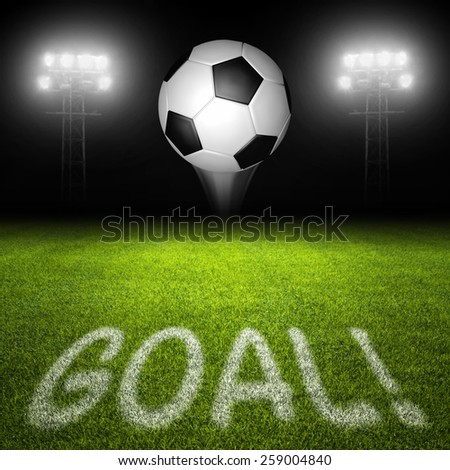 Goal word on soccer field with ball in flight and illuminated stadium lights in background - stock photo