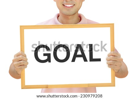 GOAL word on whiteboard held by smiling man - stock photo