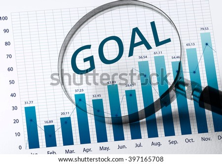 goal word with Magnifying glass and business growth graph(financial  graph).For business strategy and analysis concept.