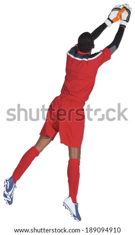 Goalkeeper in red making a save on white background