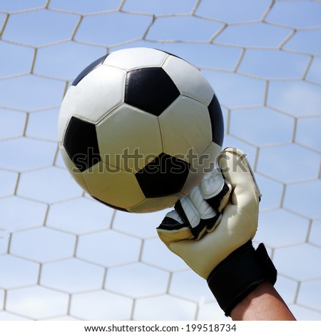goalkeeper's hands hitting for the foot ball  - stock photo