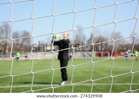 goalkeeper through the net. Women football - stock photo