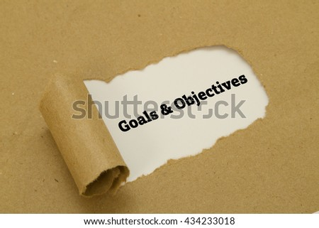 Goals and Objectives words written under torn paper. - stock photo