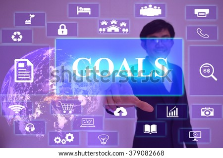 GOALS concept  presented by  businessman touching on  virtual  screen ,image element furnished by NASA - stock photo