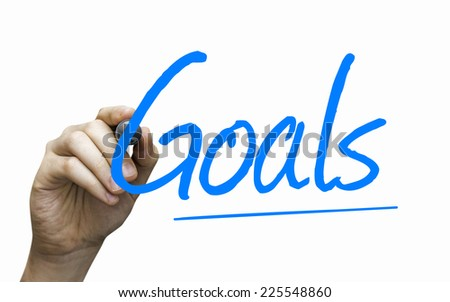 Goals hand writing with a blue mark on a transparent board - stock photo
