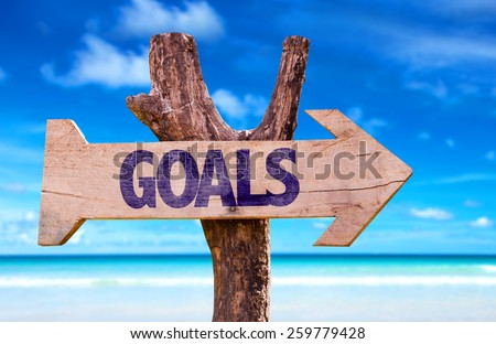 Goals wooden sign with beach background  - stock photo