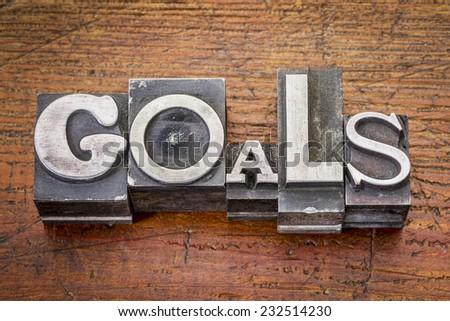 goals word in vintage metal type printing blocks over grunge wood - stock photo