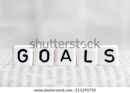 Goals word on white cube