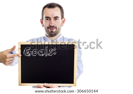 Goals: - Young businessman with blackboard - isolated on white