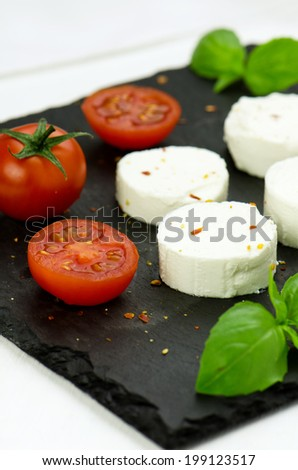 Goat cheese with cherry tomatoes and basil