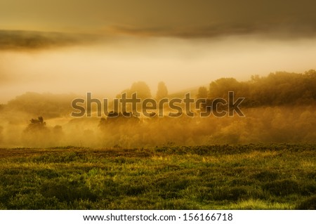 Goathland, Yorkshire, UK. Autumn mist rising at dawn over the North York Moors National Park near the village of Goathland, Yorkshire, UK. - stock photo