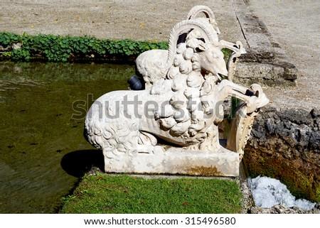 Goats Sculpture in the garden in Hellbrunn palace garden in Salzburg, Austria - stock photo