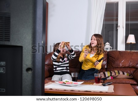 Gobble eating in front of tv - stock photo