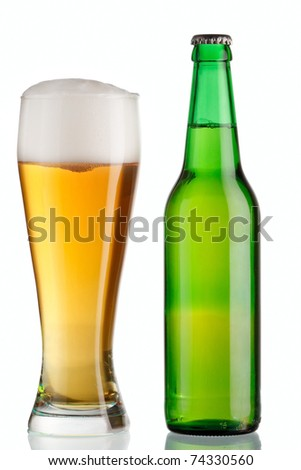 Goblet and bottle of beer - stock photo