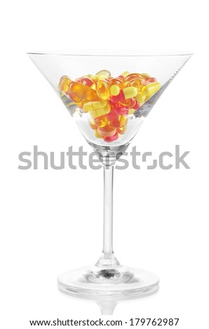 Goblet with pills isolated on white