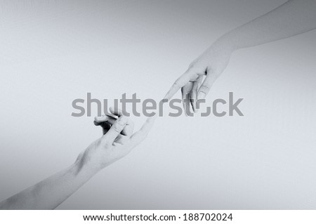God and Adam's hands from the Sistine Chapel ceiling - stock photo