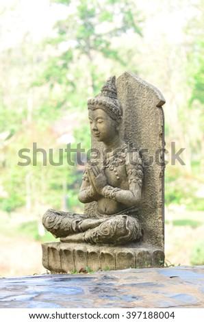 God has handing statue in garden : Thailand. - stock photo