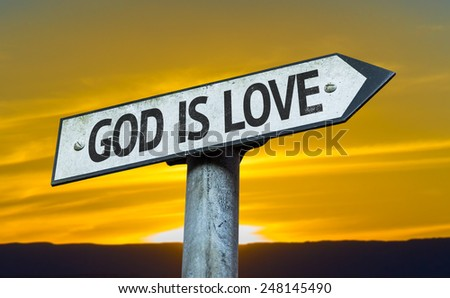 God is Love sign with a sunset background - stock photo