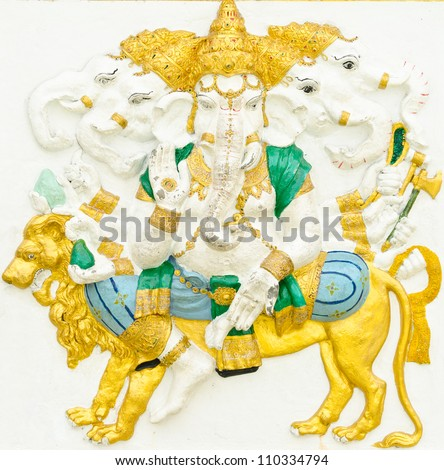 God of success 11 of 32 posture. Indian style or Hindu God Ganesha avatar image in stucco low relief technique with vivid color,Wat Samarn, Chachoengsao,Thailand. - stock photo