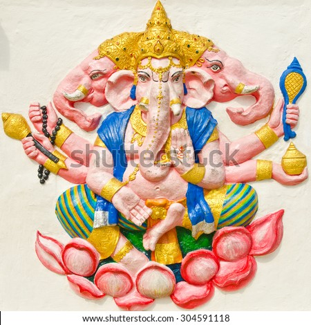 God of success 29 of 32 posture. Indian style or Hindu God Ganesha avatar image in stucco low relief technique with vivid color,Wat Samarn, Chachoengsao,Thailand. - stock photo