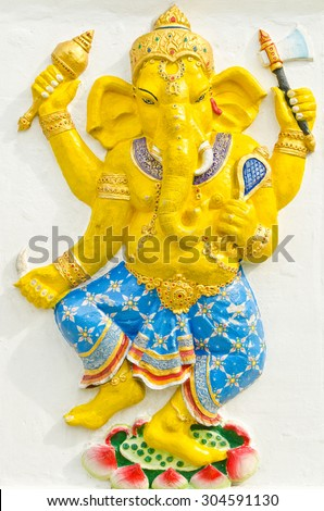 God of success 31 of 32 posture. Indian style or Hindu God Ganesha avatar image in stucco low relief technique with vivid color,Wat Samarn, Chachoengsao,Thailand. - stock photo