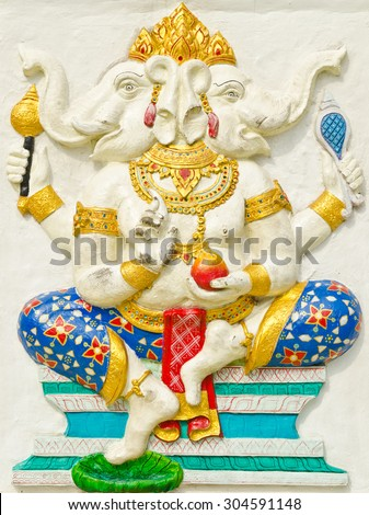 God of success 28 of 32 posture. Indian style or Hindu God Ganesha avatar image in stucco low relief technique with vivid color,Wat Samarn, Chachoengsao,Thailand. - stock photo