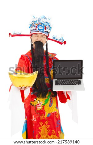 God of wealth holding a laptop and gold ingot over white background - stock photo