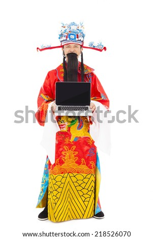 God of wealth standing and  holding a laptop over white background - stock photo
