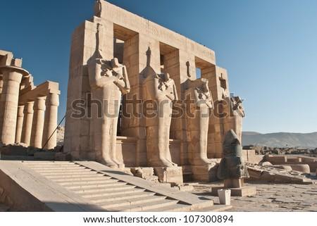 God Osiris statues.Ruins of Temple of Ramesses II - stock photo