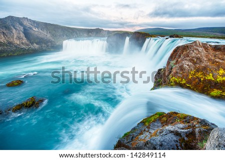 Godafoss is a very beautiful Icelandic waterfall. It is located on the North of the island not far from the lake Myvatn and the Ring Road. This photo is taken after the midnight sunset - stock photo