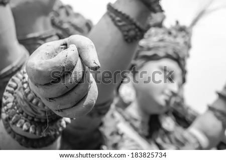 goddess durga hand full of power sculptures - stock photo