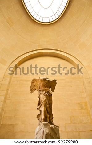 Goddess of victoria, sculpture in louvre museum - stock photo